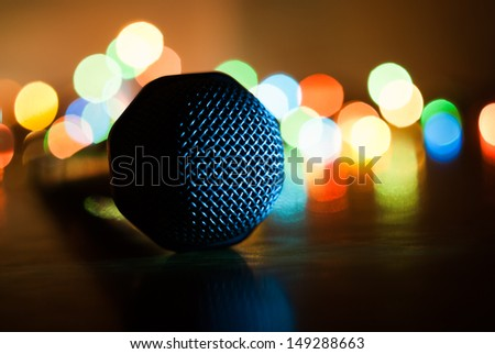 Abstract image of microphone with lights in background. Macro with extremely shallow dof. - stock photo