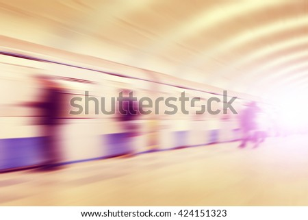 Abstract image of motion blurred people at subway station. - stock photo