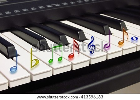 Abstract image of musical symbols on piano keys                                - stock photo