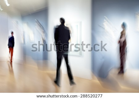 abstract image of people in the lobby of a modern art center with a blurred background - stock photo
