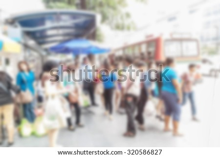 abstract image of people in town in the rush hour of a modern business center with a blurred background - stock photo