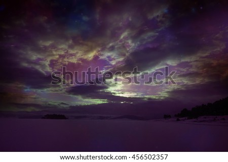 abstract infrared winter landscape with alien sky above- elements of this image are furnished by NASA - stock photo