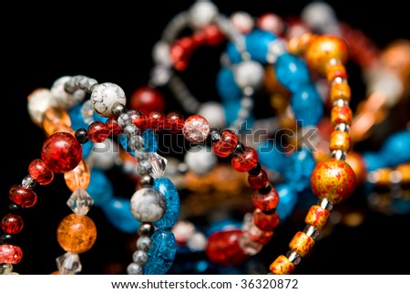 Abstract jewelery and beads background - stock photo
