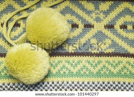 Abstract knitted background with pompoms - stock photo