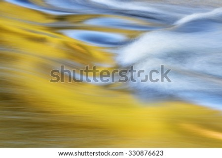 Abstract landscape of the Presque Isle River rapids captured with motion blur, Porcupine Mountains Wilderness State Park, Michigan's Upper Peninsula, USA - stock photo