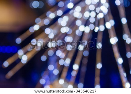 Abstract light celebration blur background with defocused lights. - stock photo