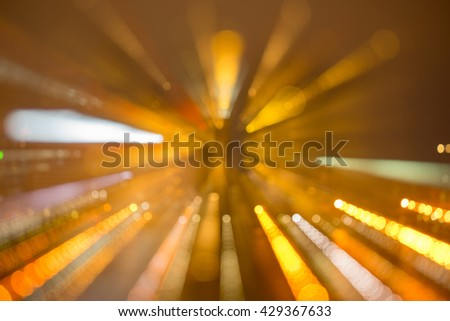 Abstract light line bokeh for background Blurred skyscrapers by night with bokeh lights trail using zoom technique - stock photo