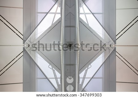 Abstract looking roof. Looked like 2 of 'x's joined together created diamond shape. - stock photo