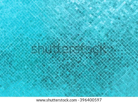 Abstract Luxury Shiny Light Blue Tone Wall Flooring Tile Glass Seamless Pattern Mosaic Background Texture for Furniture Material Art Square Seamless Pattern with Shade for Modern Interior Design Style - stock photo