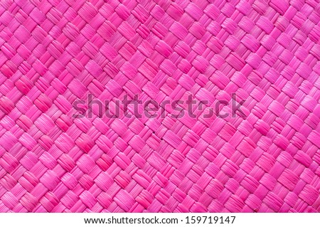 Abstract magenta background of woven straw. - stock photo