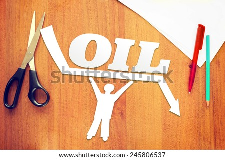 Abstract man keeps oil prices against falling. Concept of declining oil prices - stock photo