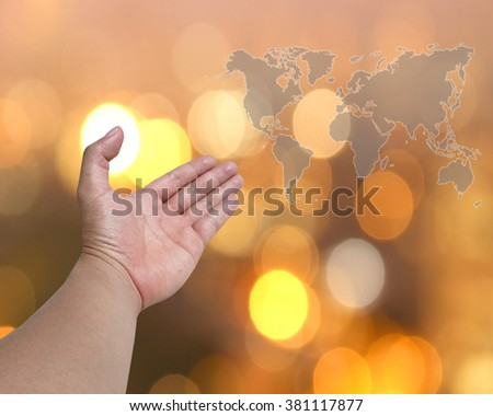 abstract map Hand with a golden background bokeh. Pray for Christians. Prayer to bless our world. The Society of the Capital - stock photo