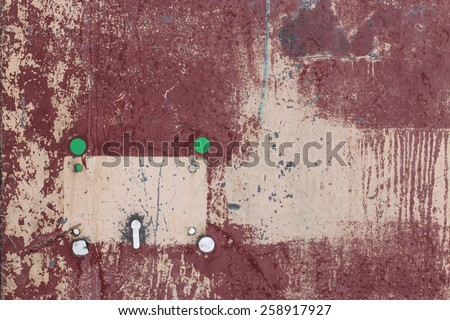 abstract metal painted sheet  background color Burgundy. Metal painted sheet with a hole for the lock - stock photo