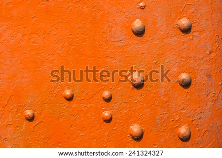 Abstract metal with knotty rivet of freight train - stock photo