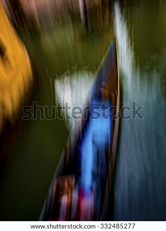 Abstract motion blur of a gondola in Venice, Italy. - stock photo
