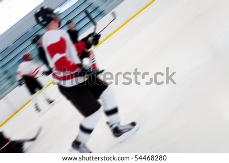 Abstract motion blur of hockey players on a fast break as they speed down the ice. - stock photo
