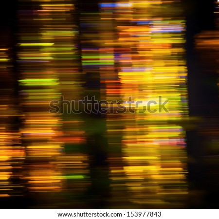 Abstract motion blur of trees in an autumn forest - stock photo