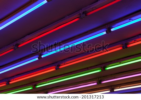 abstract multi colored neon light lines - stock photo