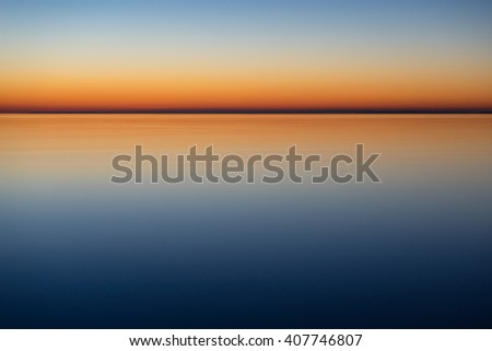 Abstract natural background of calm and mystical sea by night - stock photo