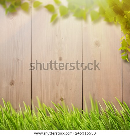 Abstract natural backgrounds with summer foliage, farm fence and bright sunlight - stock photo