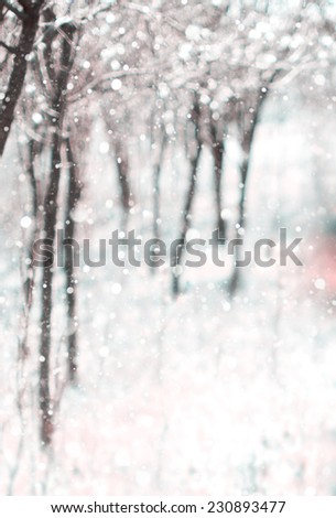 Abstract nature background, winter landscape with snow falling - stock photo