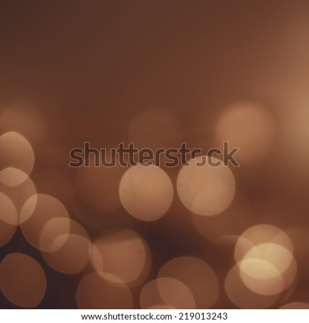 Abstract Night background with gold bokeh lights  and place for text. Beautiful Festive textured  background. Vintage defocused background. - stock photo