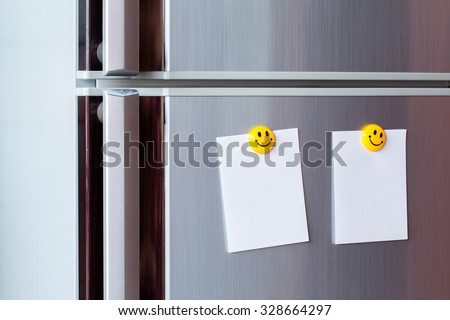 Abstract of Blank paper and post-it on refrigerator door. - stock photo