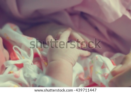 Abstract of blurred newborn baby hands in vintage tone style : people and body part concept - stock photo