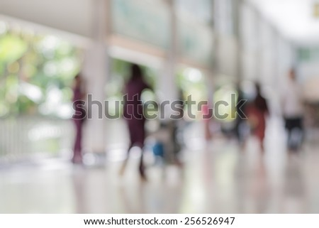 Abstract of blurred people walking in the building - stock photo
