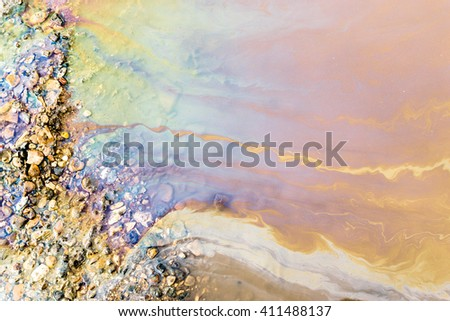 Abstract of bright vibrant oil spill shapes of pollution on the surface of water. Patterns of multi-coloured pollutants releasing hazardous chemicals into the environment. - stock photo