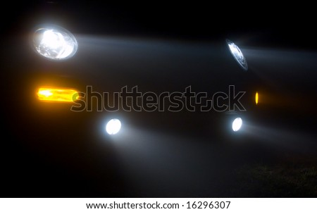 Abstract of car headlights in the fog - stock photo