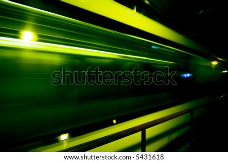 abstract of fast train passing by - stock photo