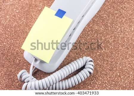 abstract of note paper on office line telephone space for add text - stock photo