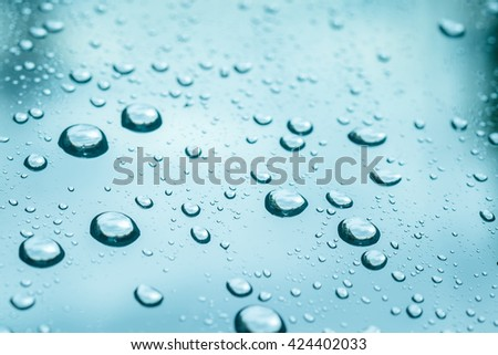Abstract of water drops on glass background - stock photo