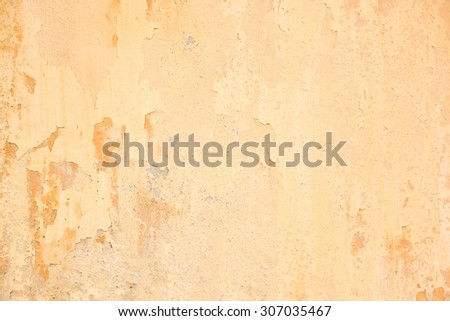 Abstract old grunge cracked orange-brown concrete wall background with crack texture and weathered pattern - stock photo