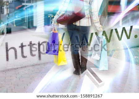 Abstract online shopping concept where a woman is walking holding bags with a website url address bar overlay. - stock photo