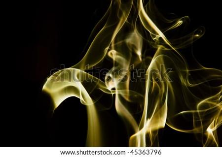 Abstract orange smoke shot against black background - stock photo