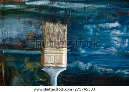 Abstract pained canvas. Oil paints on a palette and brush. Colorful art vintage background. Copy space. - stock photo