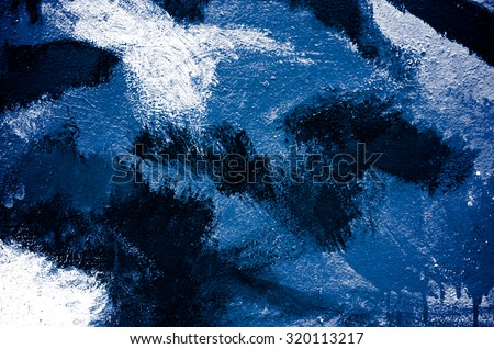 Abstract paint blue brush on wall background with kid. Acrylic hand painted with earth tone. Fashion and street. Close up. - stock photo