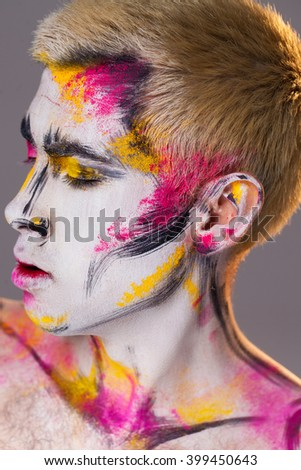 Abstract painting on man's face - stock photo
