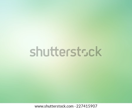 abstract pale green blurred background, white beige color spotlight in soft blended design  - stock photo