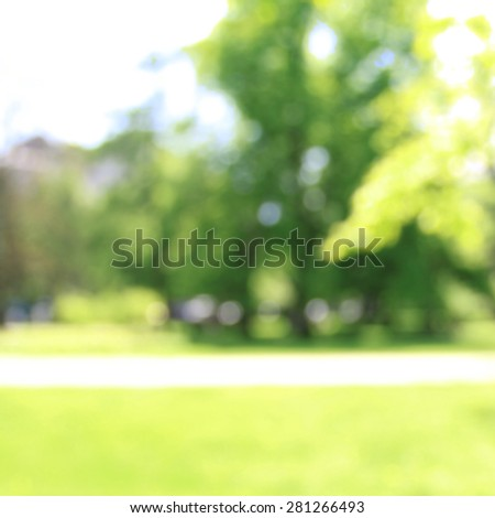 Abstract park in sunlight, blurred side view - stock photo