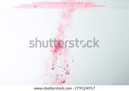 abstract pattern background with red ink in water - stock photo