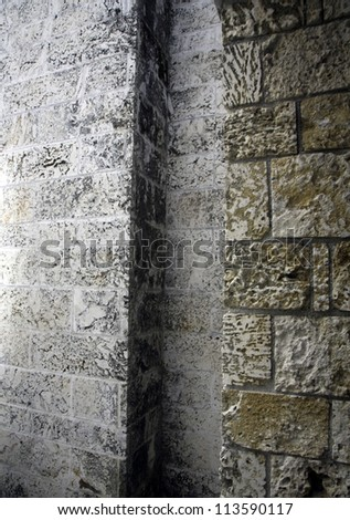 Abstract patterns in brick wall alcove - stock photo