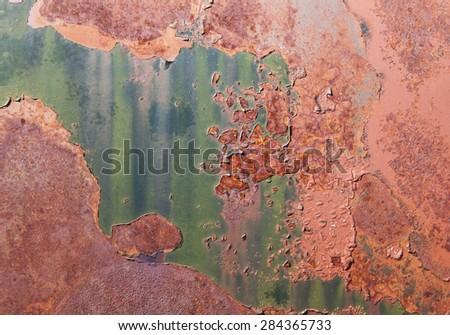 Abstract patterns on a rusty abandoned car surface with colorful patterns. - stock photo