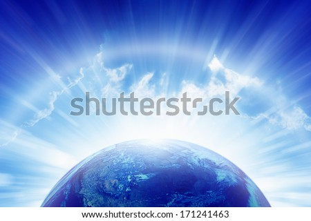 Abstract peaceful background - planet Earth, bright sun shines, blue sky, eternity and heaven. Elements of this image furnished by NASA - stock photo