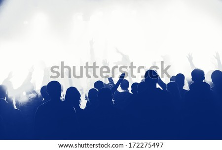 abstract photo of cheering crowd at concert - stock photo