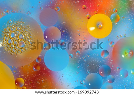 Abstract photograph of oil drops on water - stock photo