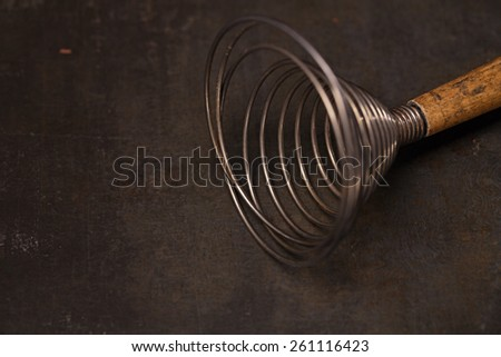 abstract picture with Vintage egg beater whisk, tiny focus - stock photo