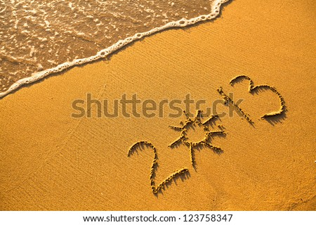 Abstract picture: 2013 written in sand on beach texture (soft wave of the sea) - stock photo
